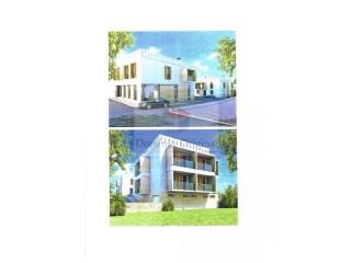 Vende-se terreno urbano com projecto para 6 apartamentos e 2 lojas em Paderne / Albufeira |
