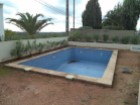 Pool area of Villa with sea view in the Algarve%11/12