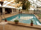 House in Beloura - Sintra, inserted in a plot of 505 m2 composed of 4 rooms with swimming pool | 4 Bedrooms | 3WC