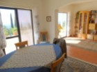 House 3 bedrooms detached villa with pool and sea view, in Estoi-dining room and living room%19/21
