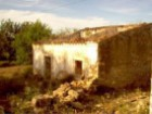 Farm with house in ruins |