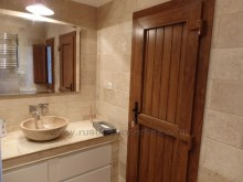 Guests bathroom with door to pool area%26/43