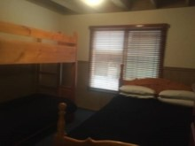 Bedroom with queen bed & a set of bunks%12/17