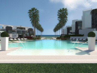 Terraced houses in 1st line Beach in construction in exclusive residential luxury in Estepona.