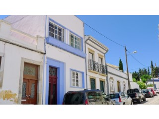 A townhouse with two apartments. Located in the city center. |