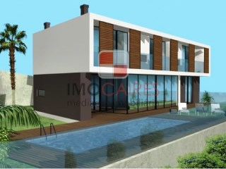 Building plot with approved project for a 3 bedroom house with pool and sea view |