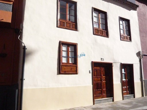 restored house in a pedestrian street in the city center Heritage city |