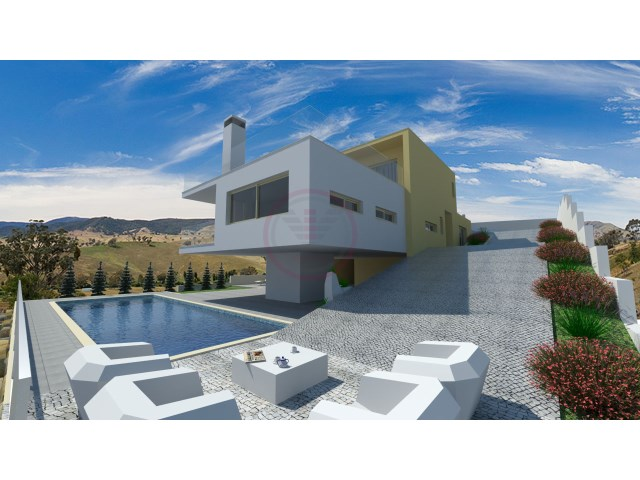 Plot of land with sea views and with project for a contemporary villas |