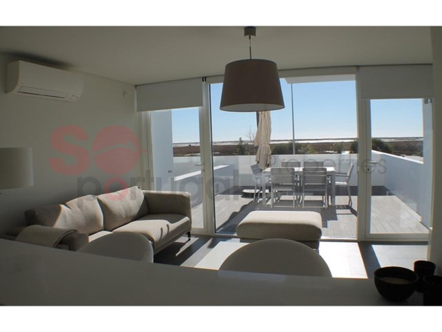 Contemporary property with stunning views over the Ria Formosa to the sea.