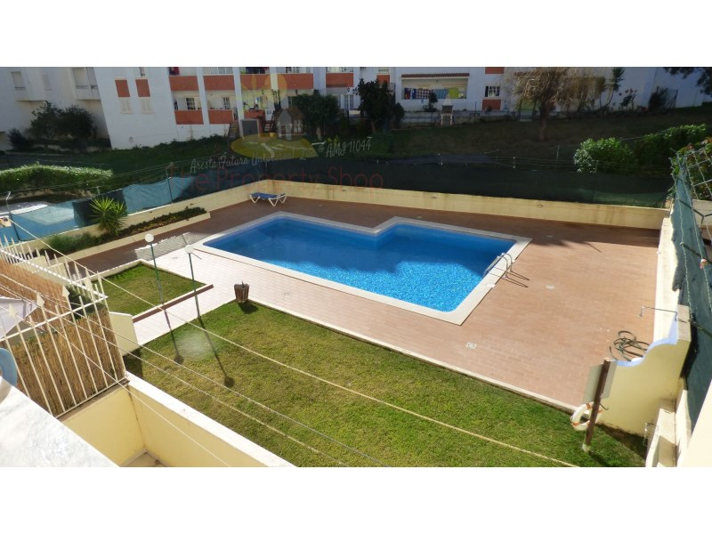 Condominium consisting of 16 apartments close to the Montechoro area of Albufeira just 5 minutes from the Bull ring roundabout and the Strip..There is a large shared pool which has recently refurbished, and the general condition is very good,