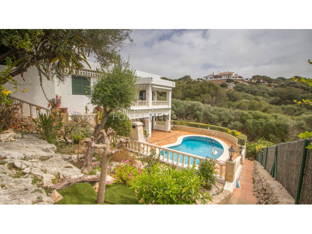 House for sale in Menorca with swimming pool and sea view\n