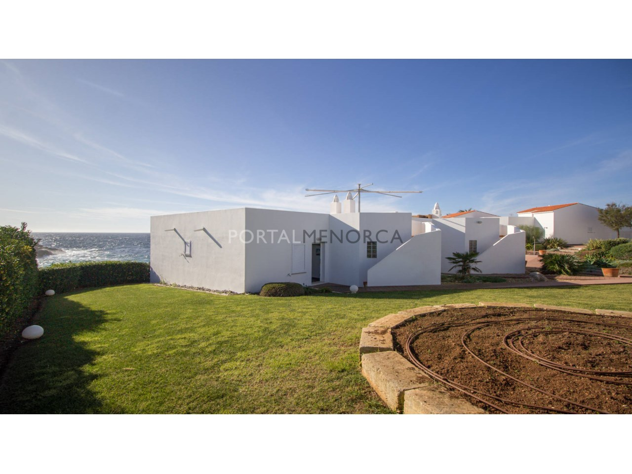 Frontline house with sea view for sale in Binibeca Vell