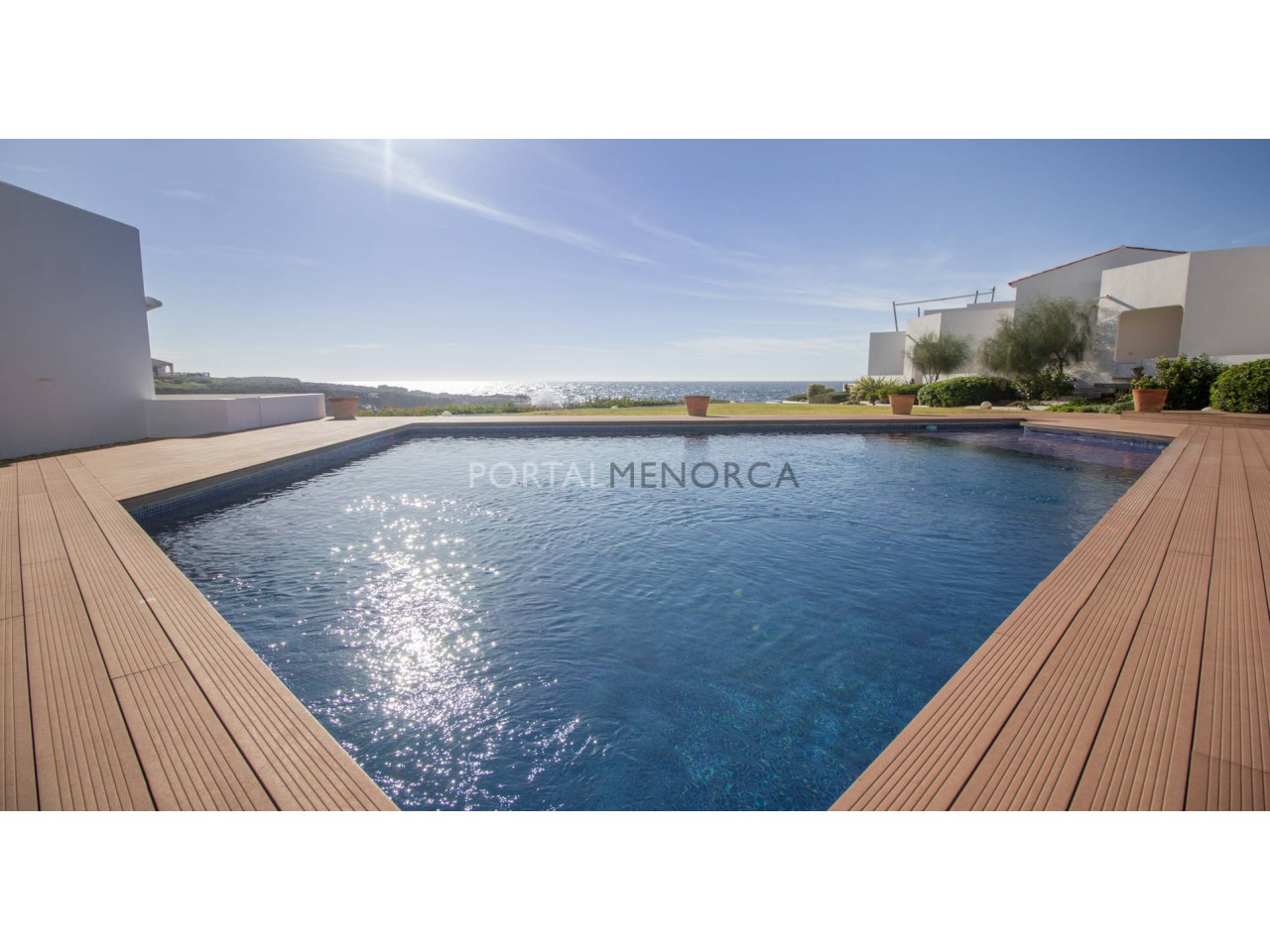 Frontline house with sea view and comunity pool for sale in Menorca