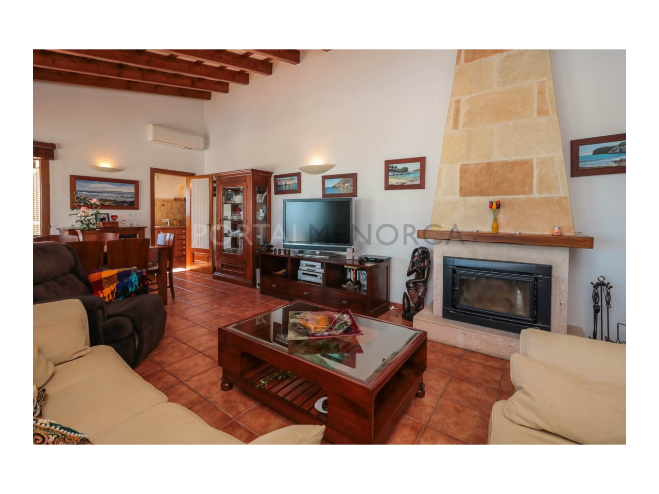 Villa for sale in Cala Morell with sea views and tourist license-Living room with fireplace