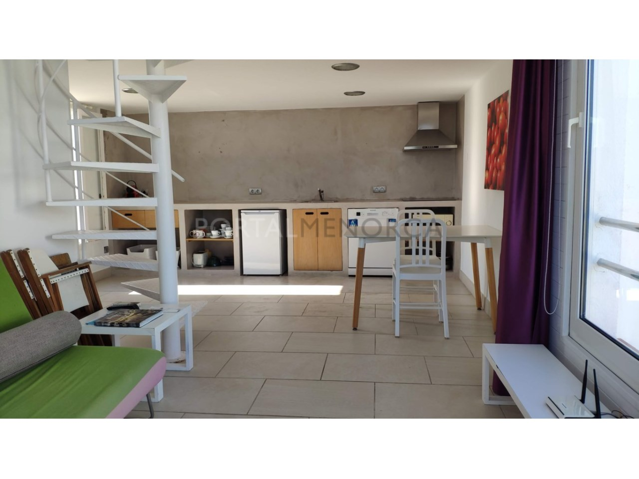 Modern apartment with sea views for sale in Cala Blanca Ciutadella Menorca Living room and Kitchen