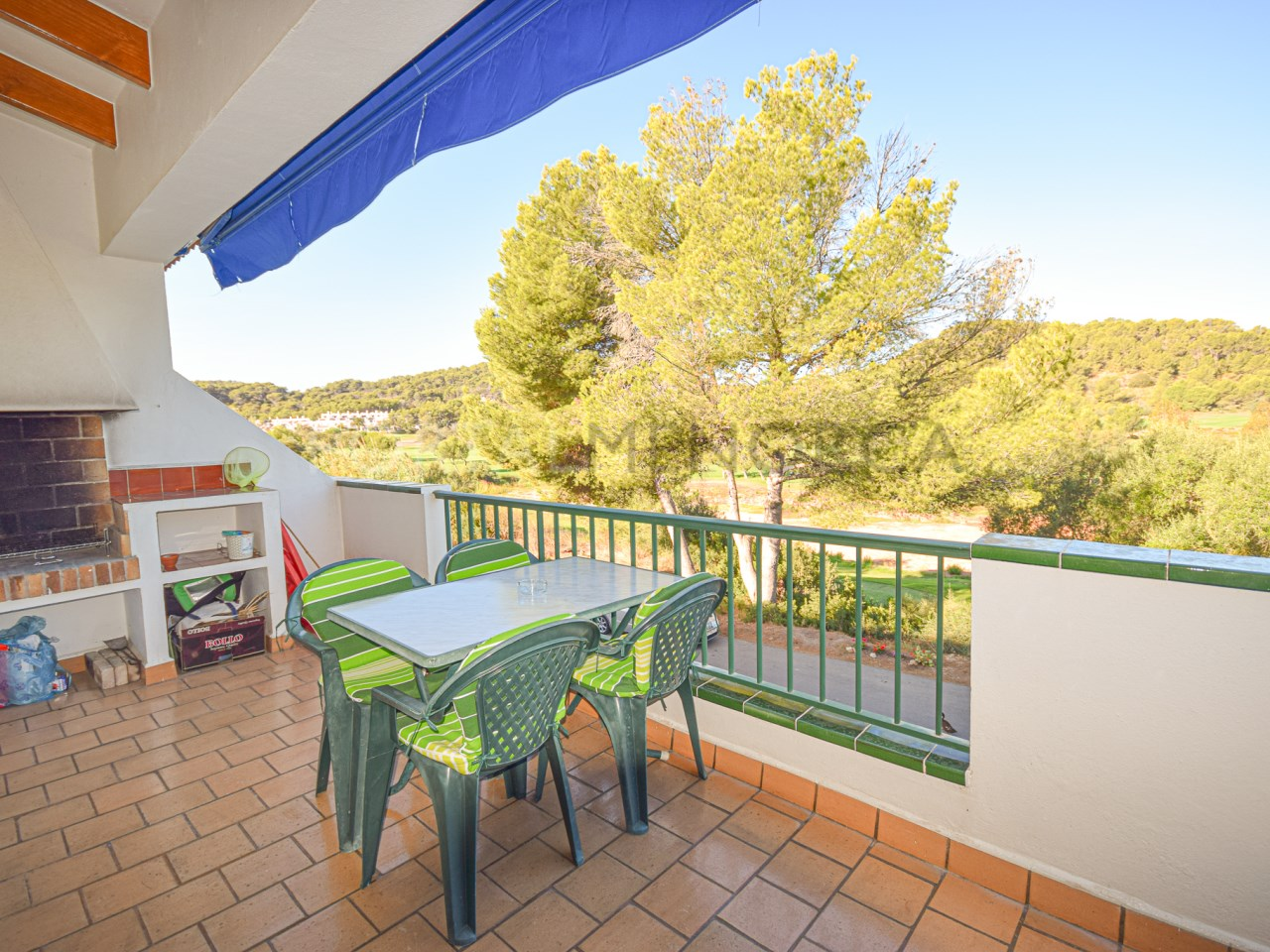 Apartment with pool opposite the golf course